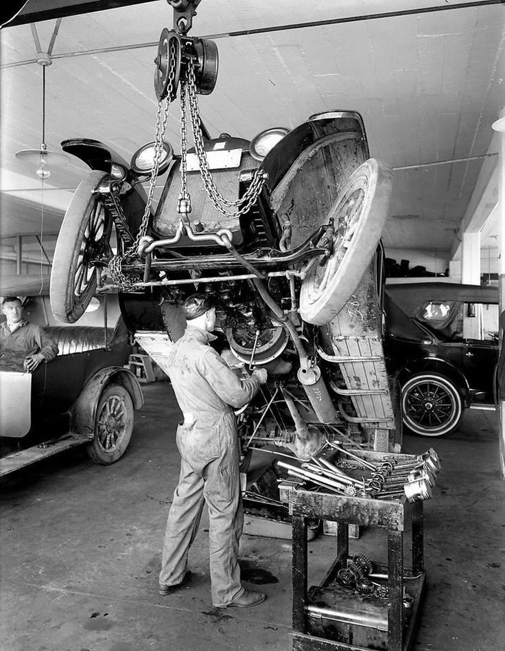 Mechanic working on a buick old auto repair shops for Garage reparation ford
