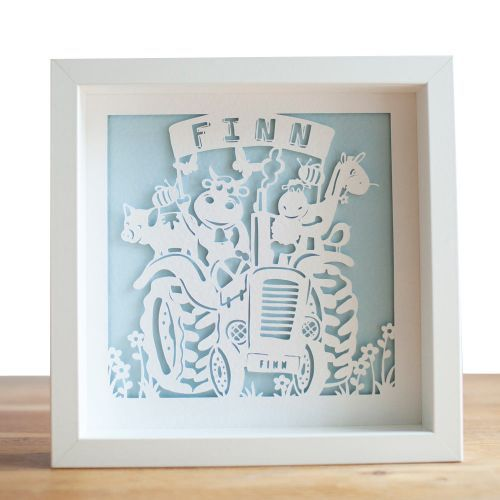 Personalised Tractor Paper Cut – Framed This quirky personalised paper cut displays the recipient's name in a large banner and also within the tractor registration plate. Cute farm yard animals, bees and butterflies surround this tractor based design.   £69.99