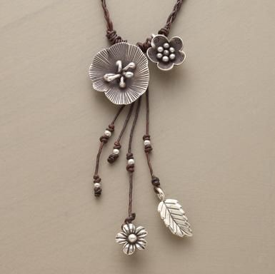 """Macrame Necklace  Macramé weavings of waxed cotton cord interlace sterling silver beads and charms inspired by the natural world. Each handcrafted necklace is subtly different. Lobster clasp. Approx. 18""""L."""