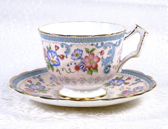 Aynsley Tea Cup and Saucer, Crocus Shape, Delicate Floral over Soft Pink, Edged with Turquoise and Gold Gilt Trim, Made in England, 1970s