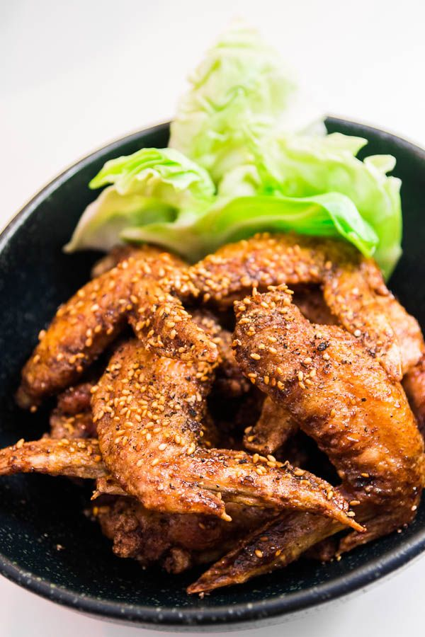 """If i had a board called """"things i will probably never do"""" - I would post this there : )  but they do sound good ! If you decide to make them, call me !!  Impossibly crispy Japanese chicken wings with an invisible sweet soy glaze and plenty of black pepper."""