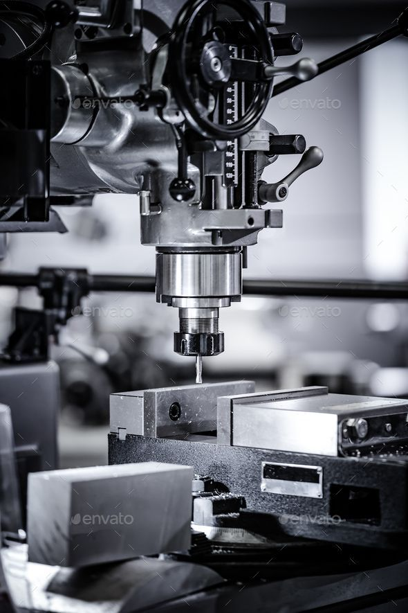 Metalworking CNC milling machine. by cookelma. Metalworking CNC milling machine. Cutting metal modern processing technology. Small depth of field. Warning ¨C authent...