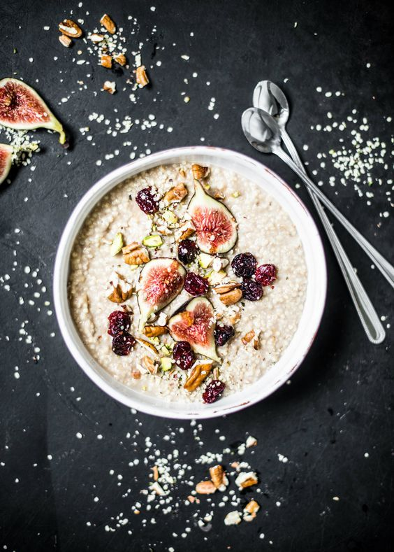 Millet-cinnamon porridge with fresh figs, cranberries and roasted nuts