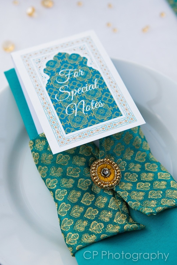 Temple of Dreams Asian napkin wrap with ethnic embellishment.  Matching note book favour by www.fuschiadesigns.co.uk.