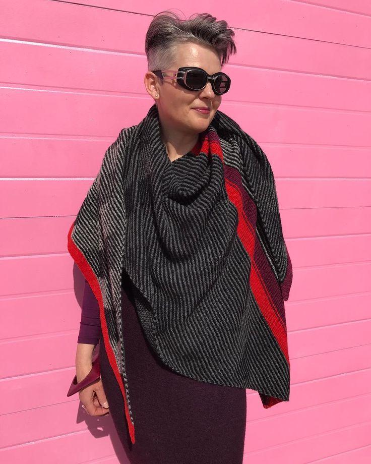 Hand knit shawl using shadow knitting techniques by Vivian Hoxbro. Pattern is Wing Shawl. Black, gray, charcoal, burgundy and orange yarns by Harrisville Yarns.   #vivianhøxbro #wingshawl #harrisvilleyarn #yohjiyamamotosunglasses #over50style #iknit #handknitshawl #over50andfabulous #50plusandfabulous  #over50 #over40 #greyhair #makemyself #madebyme #greyhairdontcare #50plusstyle  #beehiveyarnshop