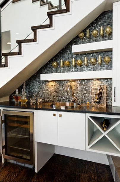 Utilize the space under the stairs by building a bar area complete with sink and wine storage. (Image via Houzz) More creative storage ideas on the blog http://decoratingfiles.com/storage-ideas-diy-projects/