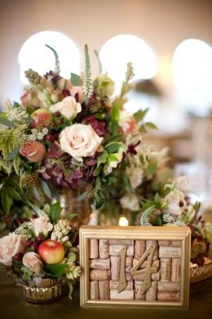 Creative idea for a rustic or fall wedding. Framed wine corks with brass table numbers.