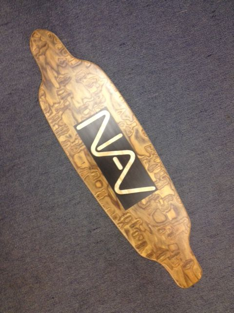 NAV's very own skateboard deck...made by the creative students at Maitland Grossmann High School have made Marquetry layers using NAV veneers for the skateboard decks.