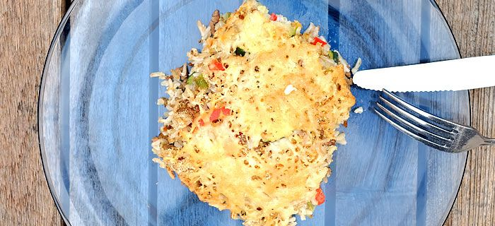 Gegratineerde ovenschotel met courgette, rijst en gehakt. Kookidee.nl