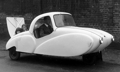 One happy family... In the Allard Clipper microcar (1953). As of 2001 there were only three survivors. That is: only 3 cars still existed.