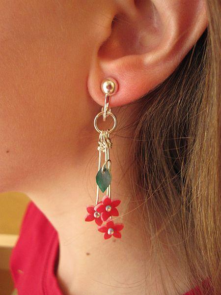 Shrink plastic earrings using this tutorial . http://justsomethingimade.com/2009/05/shrinky-dink-flowers-leaves/