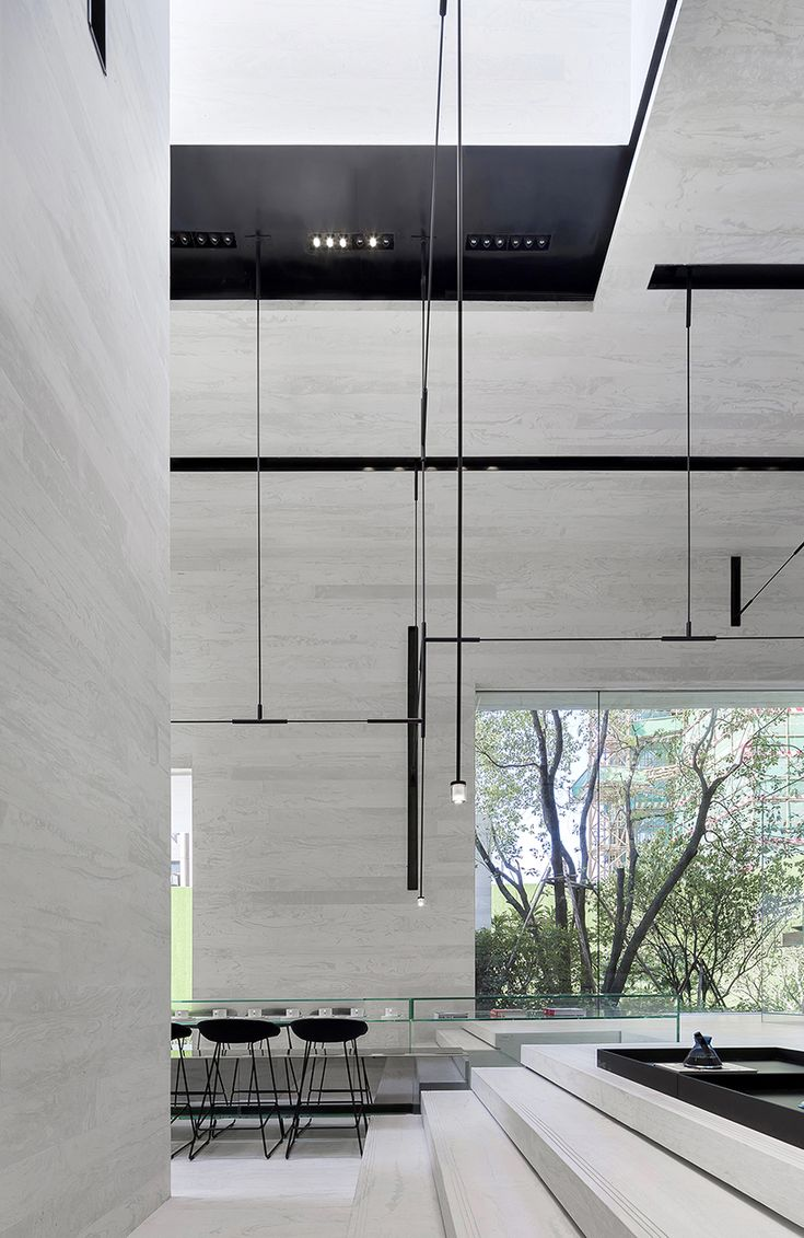 DOMANI's light-colored sky club house in china manifests a simple and vital atmosphere