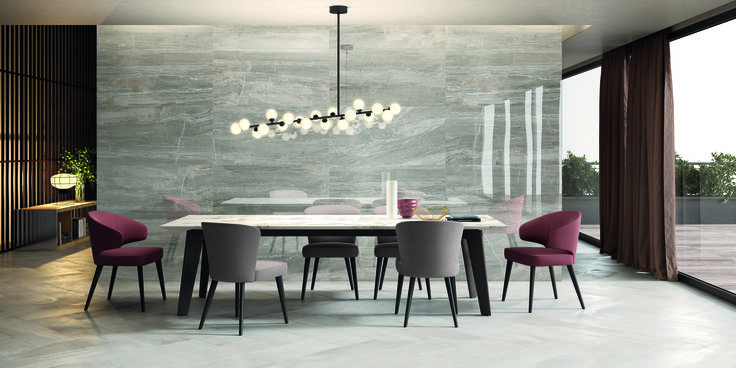 Interno 9 is a colored body porcelain stoneware that lets you imagine living spaces with a minimalist feel, where the viewer's gaze is drawn to linear structures, harmonious forms, and contrasting textures. Stylish simplicity is paired with the untamed irreverent coarseness of weathering steel.