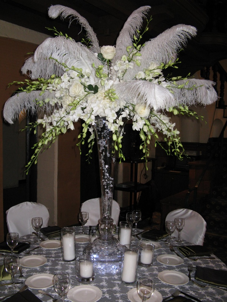 would be perfect with hanging strands of crystal and no greens for a white on white wedding---what i'd do if i were getting married now---an all white, 1920s art deco glam wedding.