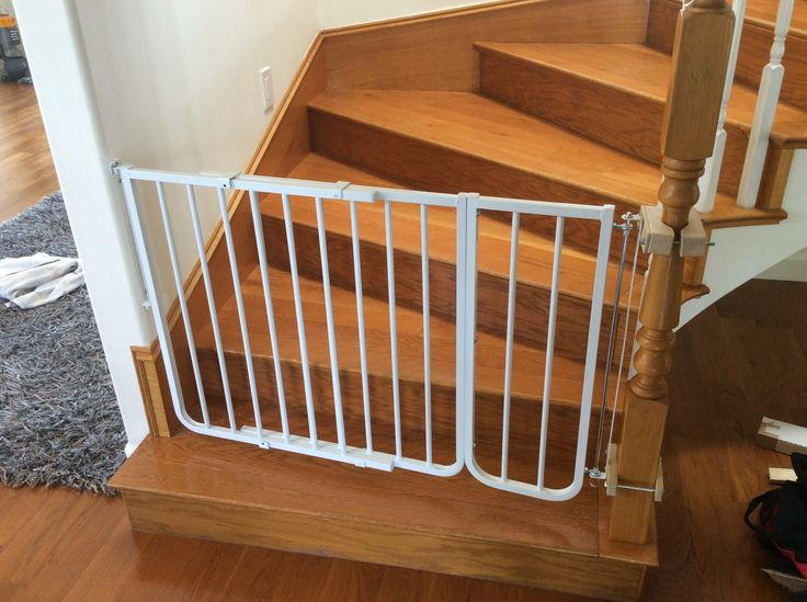 installed easy to use retractable gate at the bottom of the stairs