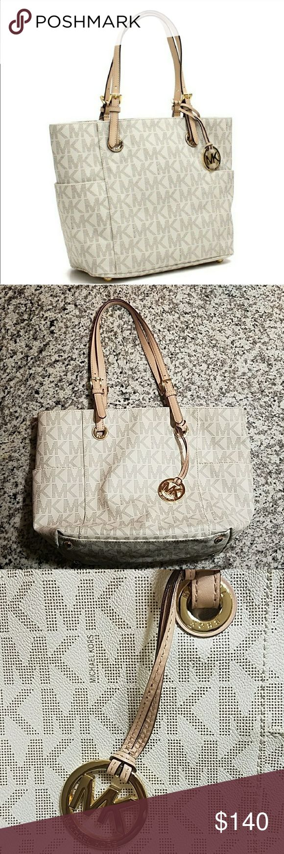 Michael Kors Jet Set Vanilla East West Tote Authentic MICHAEL Michael Kors Jet Set East West tote. MK logo in cream. Barely used. Excellent condition, looks new. Does not include duster bag. Michael Kors Bags Totes