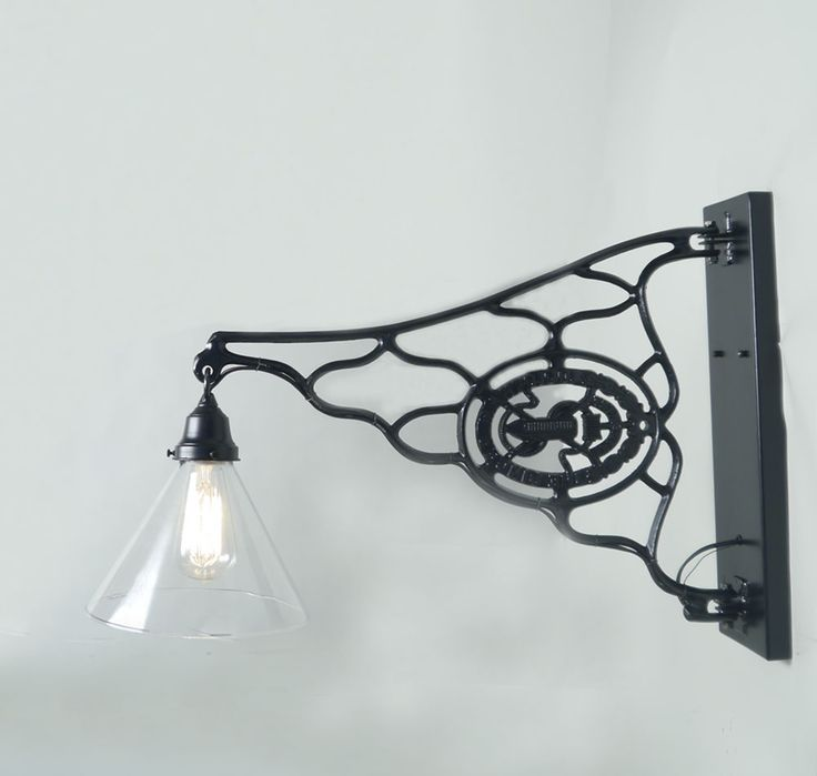 Here's another idea for vintage sewing machine legs.  This repurposed sconce  rotates from the back plate which allows you to direct the lig...