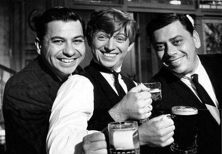 THE TWO SHERMAN BROTHERS WHO WROTE THE MUSIC ARE ON EACH SIDE OF TOMMY STEELE.  THEY WROTE MARY POPPINS AND MANY DISNEY SONGS.