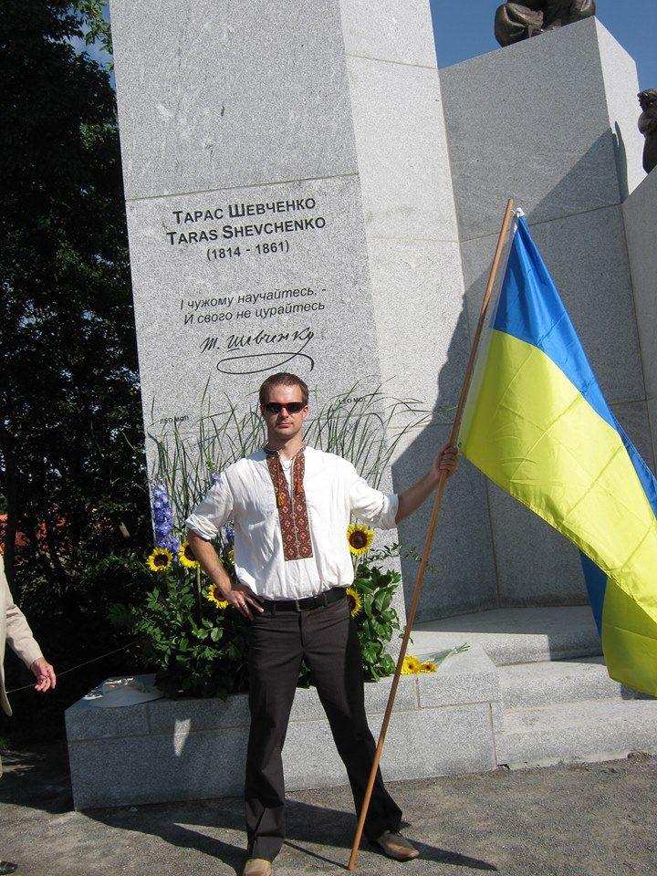 Adrian Dubyk beside the newly uncovered monument to Taras Shevchenko in Ottawa, Canada
