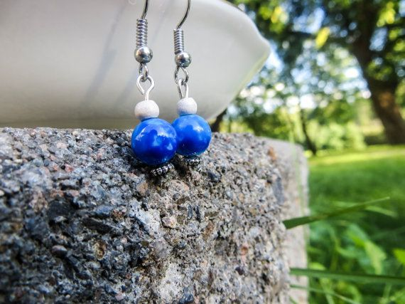 White, and blue, and silver, oh my! White wood, blue glass beads, and silver detailed headpins make these beauties one-of-a-kind. $8.75