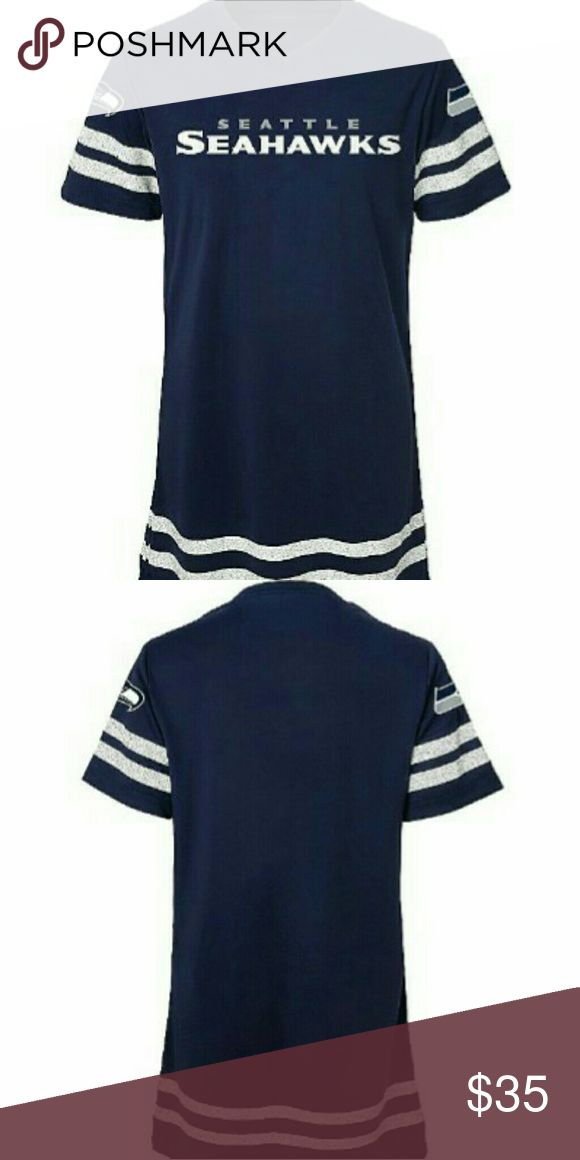 """Seattle Seahawks Football Dress Sporty and cute collide to form this girl's """" Seattle Sea hawk's football dress ! The fabric content is cotton / polyester jersey. Features: team graphic on front, v- neck , short sleeves. Handle and care : machine wash. Dresses Casual"""