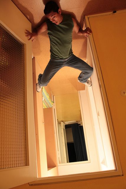 Stuck to floor and rotate picture to make it look like you're stuck to the ceiling. Cool perspective