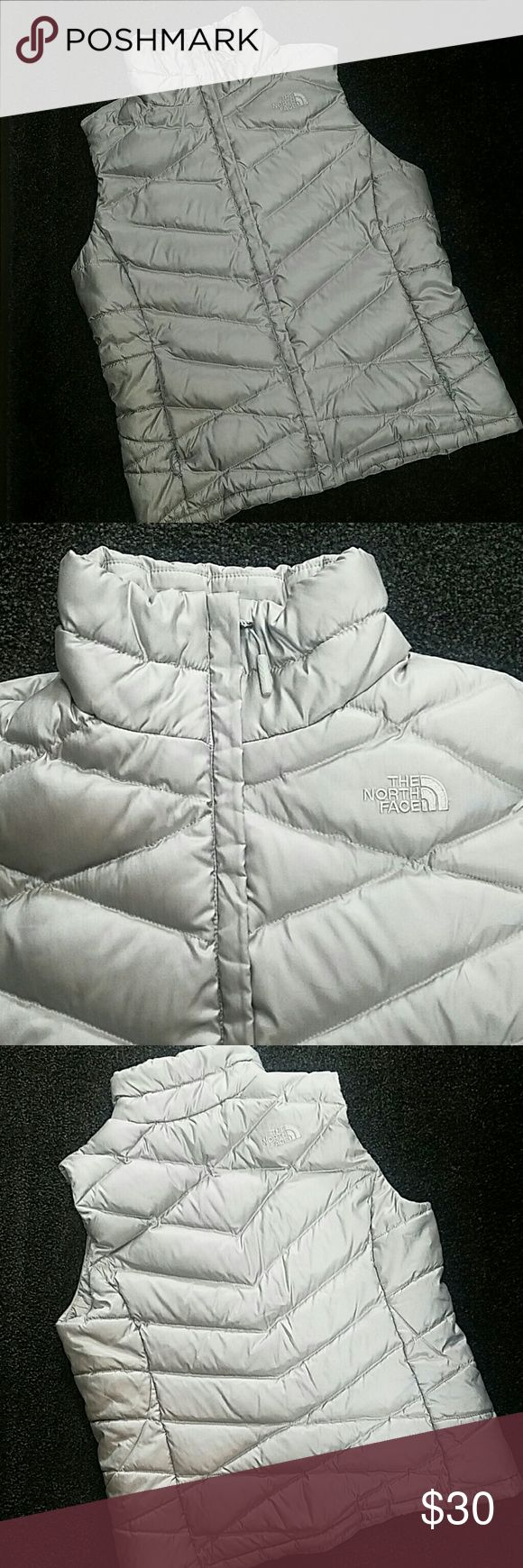 THE NORTH FACE Vest Gray The North Face Vest. In great condition.   **All of my items ship with a free gift** The North Face Jackets & Coats Vests