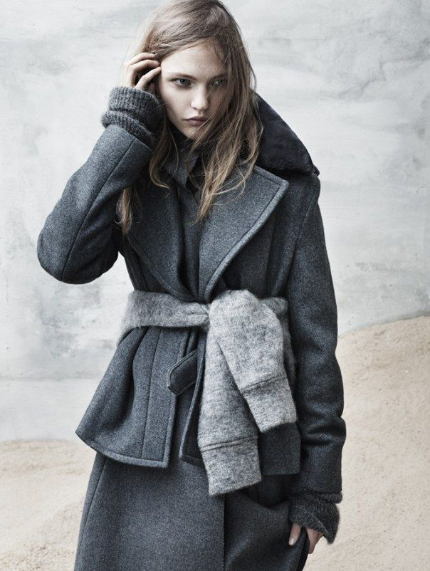 Sasha Pivovarova by Josh Olins wearing a grey cozy fashion coat