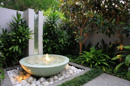 minimalist courtyard lighting with fountain design 450x300 Modern Courtyard Landscaping Ideas