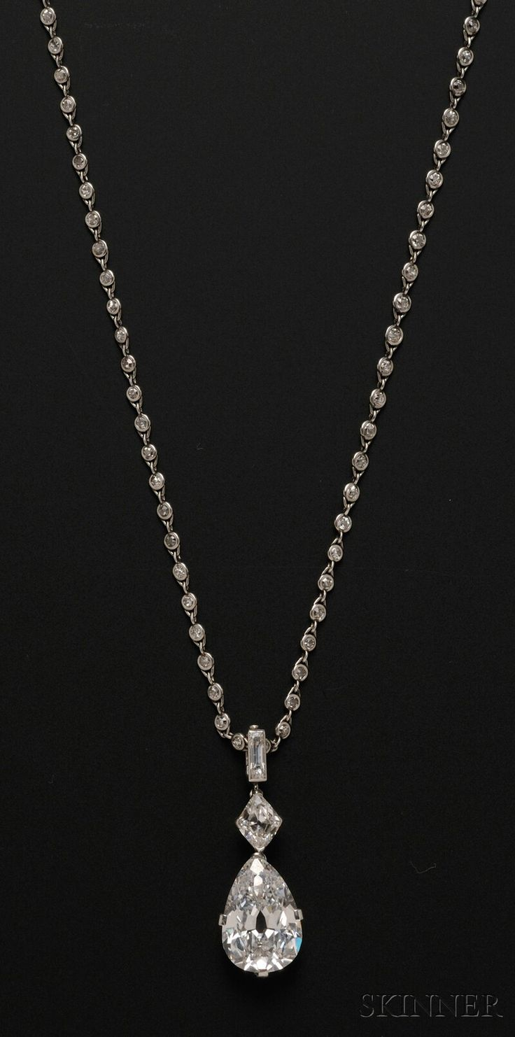 Cartier Diamond Necklace to die for..FINE JEWELRY - SALE 2601B - LOT 580 - IMPORTANT ART DECO PLATINUM AND DIAMOND PENDANT NECKLACE, CARTIER, NEW YORK, SET WITH A PEAR-SHAPE DIAMOND WEIGHING 7.93 CTS., AND A KI - Skinner Inc