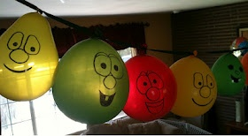 Draw faces on balloons to make a Veggietales balloon banner. A quick and easy kid's party idea!