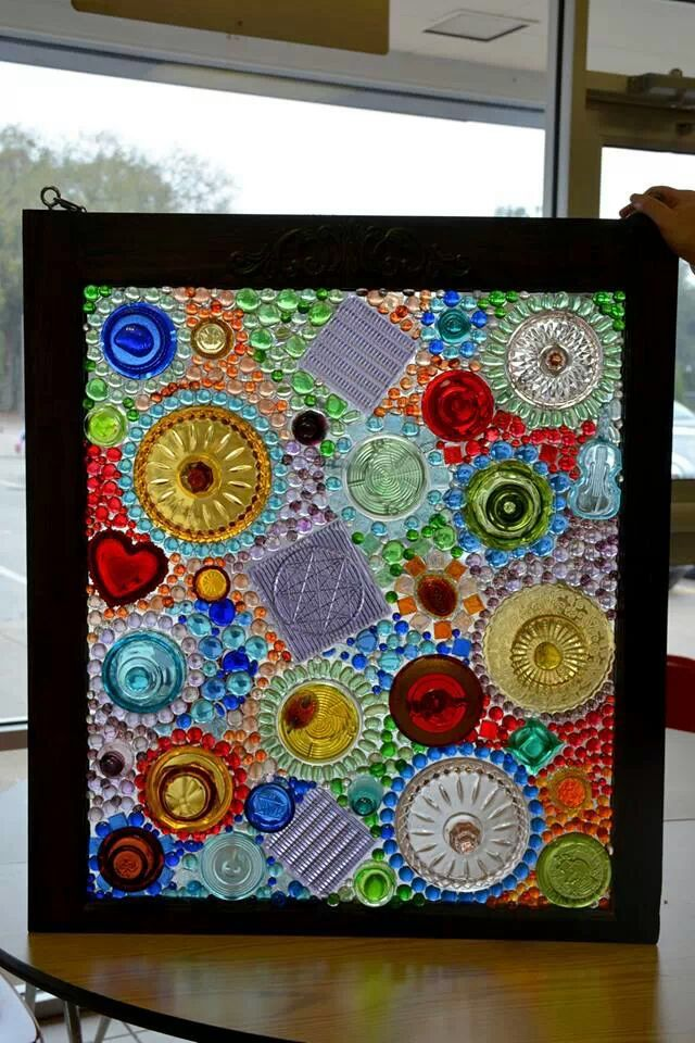 Old framed window using recycled glass pieces to create a dimensional stain glass window . Using clear silicone adhesive .