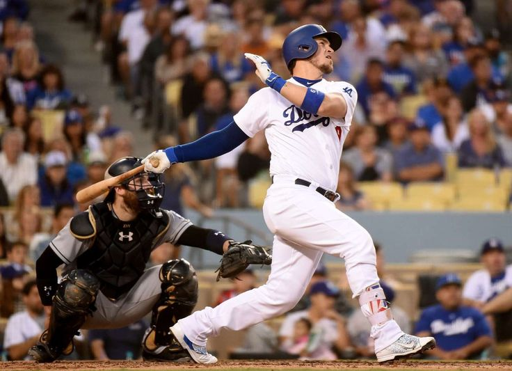 Watching it gone:    Dodgers' Yasmani Grandal hits a three run homerun against Padres during the fourth inning on Sept. 3 in Los Angeles. Dodgers won 5-1.