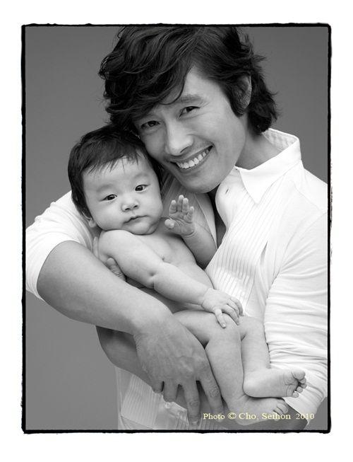 Hot Korean star holding cute baby