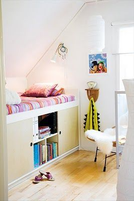 loft bed w/ built-in storage underneath These types of built in beds would totally limit what could be done w/ other furniture in a room, but so cool for those little often wasted nooks in a room w/ a slanted ceiling!