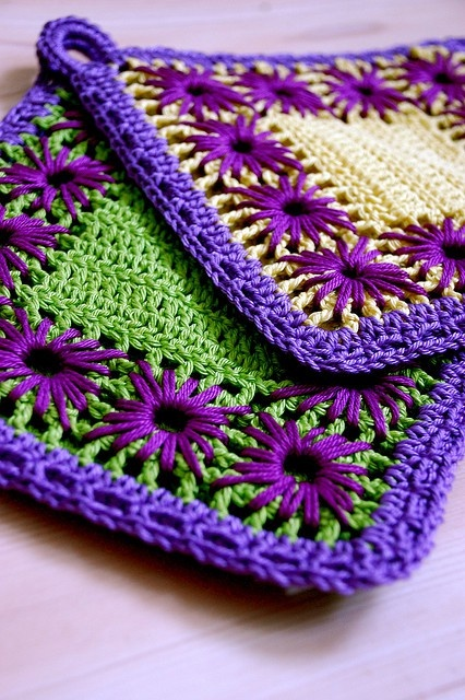 crocheted square with embroidered flowers