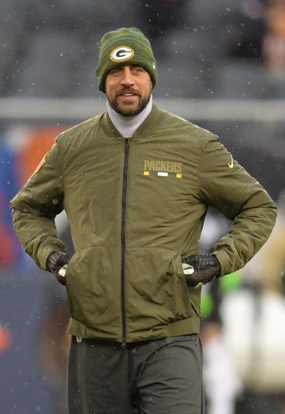 Aaron Rodgers Photos - Quarterback Aaron Rodgers #12 of the Green Bay Packers walks on the field during warm-ups prior to the game against the Chicago Bears at Soldier Field on November 12, 2017 in Chicago, Illinois. - Green Bay Packers v Chicago Bears