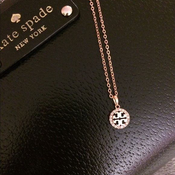 Cute little rose gold diamond Necklace Brand new. Never used. Got it as a gift. Great to wear with any outfits. Cute and simple everyday wear. Listing is for necklace only. Kate spade wallet is not included. Jewelry Necklaces