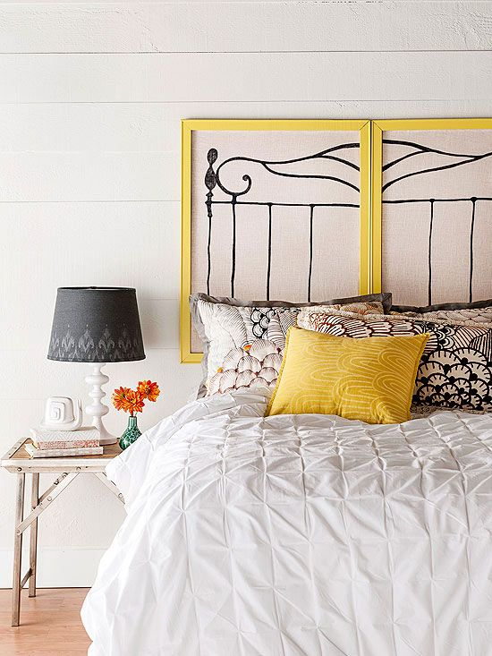 Simple and cheap- paint and hang old photo frames or pin boards above the bed