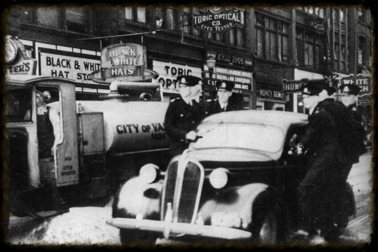Patrol officers headed to a call while on the sidesteps of police car, date unknown.