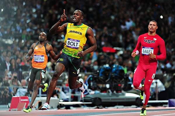 #UsainBolt sets Olympic record in 100-meter dash