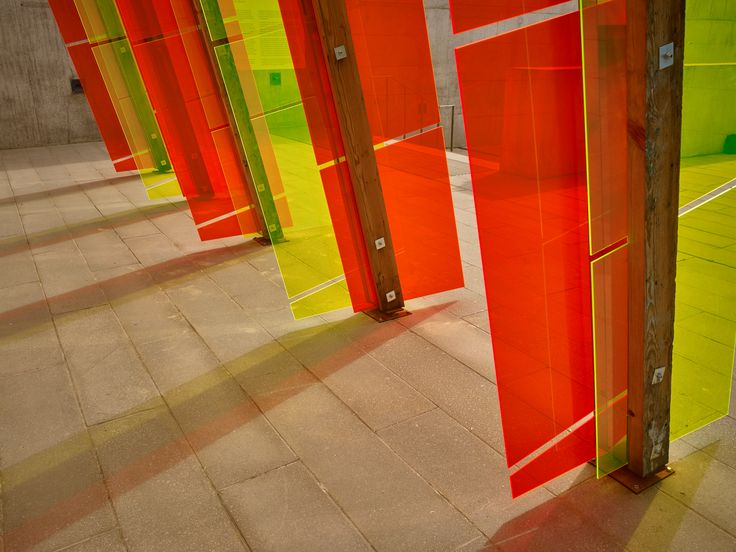 Jyll Bradley's installation is named after Agneta Block, the first person to ripen a pineapple in Europe, thanks to Dutch greenhouse techniques – a cultural exchange made possible because of the end of the Anglo-Dutch wars. The artwork glows with the sun, and casts geometric orange and green shapes, and shadows, on visitors walking beneath. Photo: Stephen White