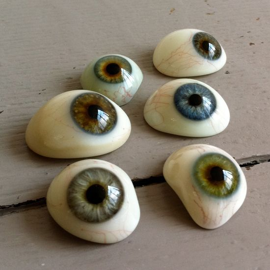 creepy cool craft idea - paint eyeball rocks