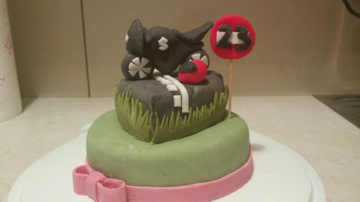 Cake with suzuki motorbike topper