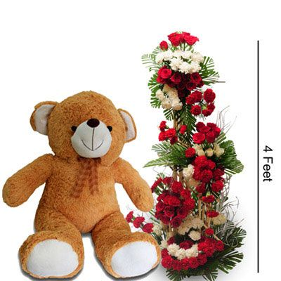 4 Feet tall arrangment of 50 Red Roses, 25 white Roses, 50 Red Carnatoions & 25 White carnations with 3 feet tall Teddy Bear. http://www.fnp.com/flowers/unconditional-pure-love/--clI_2-cI_1123-pI_23661-i_23307.html