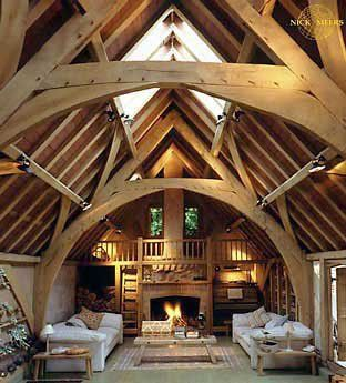 I love the loft, wood, built on bookcases, and central hearth.  Too grand for me though...