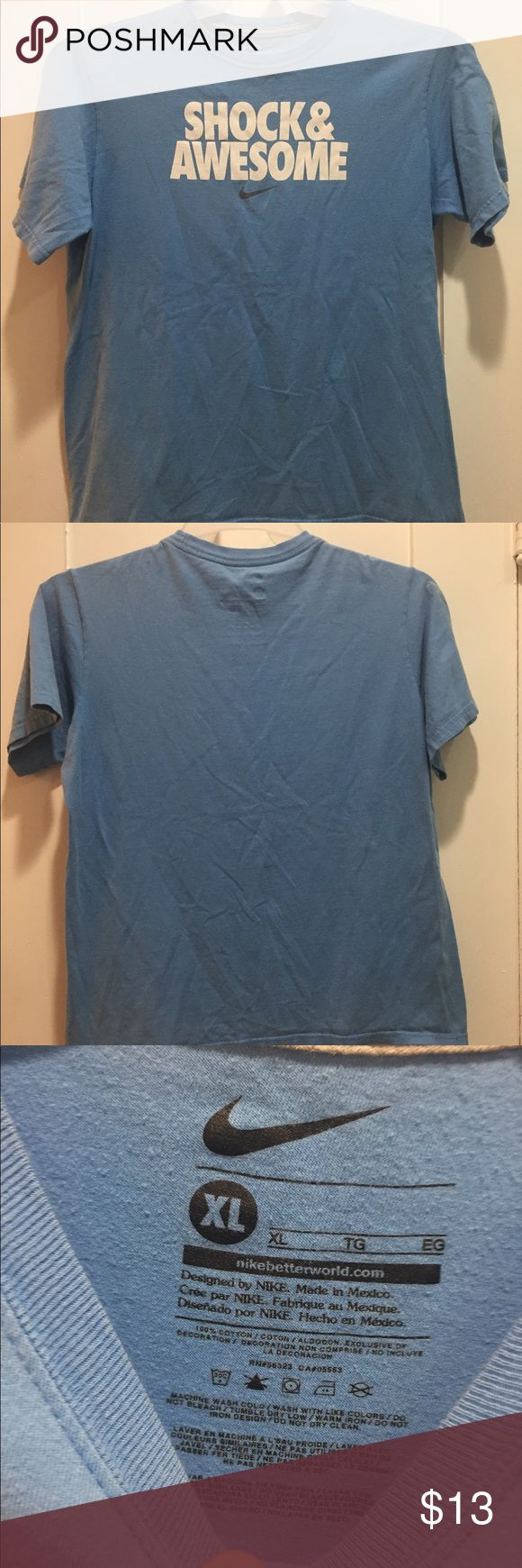 Nike Shock & Awesome Tee Nike Shock & Awesome Short Sleeve Tee. In good condition besides a few stains shown in the last two pictures. Size small boys XL but would fit women's size small. Nike Shirts & Tops Tees - Short Sleeve
