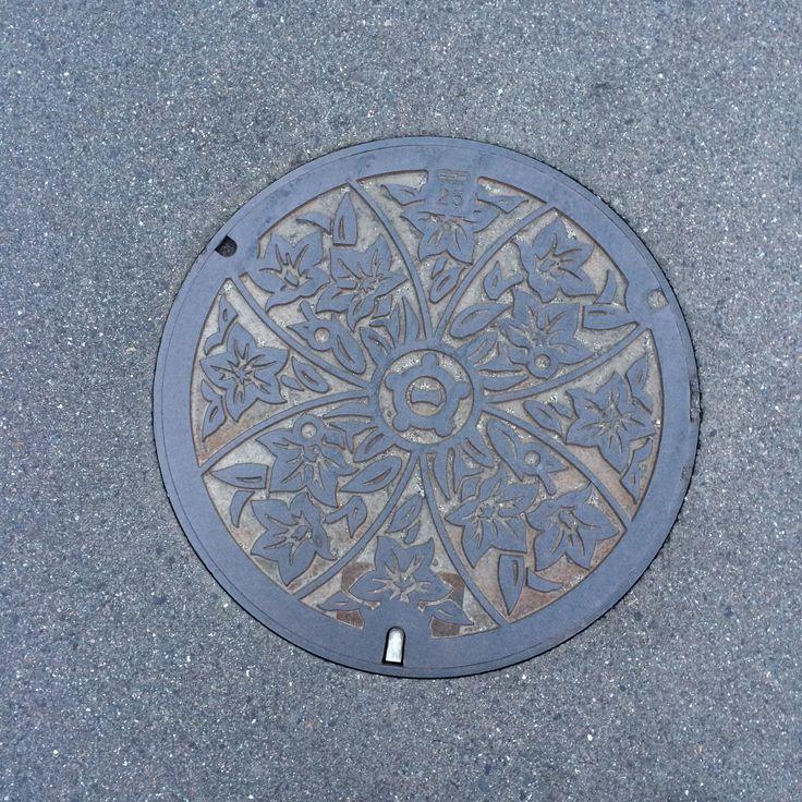 Chinese bellflower manhole cover. Place: Ichinomiya city, Aichi, Japan.