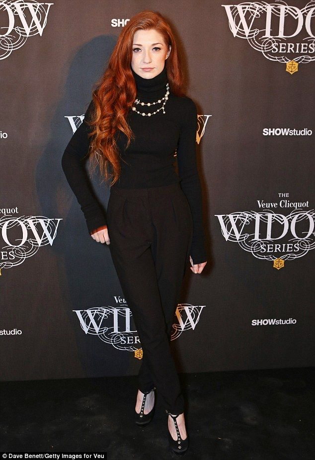 Any colour as long as it's black: Pop star Nicola Roberts went for head-to-toe black in trousers and a turtleneck