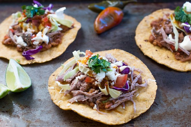 Pork Carnitas Tostadas Recipe - http://www.sofabfood.com/pork-carnitas-tostadas-recipe/  Elevate your game day party fare when you serve up the flavorful combination of Pork Carnitas Tostadaswith a side of Spinach Artichoke Dip. These tostadas are as colorful as they are delicious making the party table even more enticing to your guests!#FlavorsOfTheGame The following content is i...